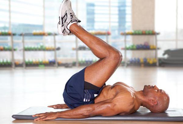 A man doing reverse crunches