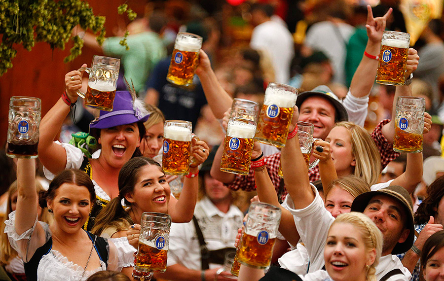 People raising beer glasses at Octoberfest