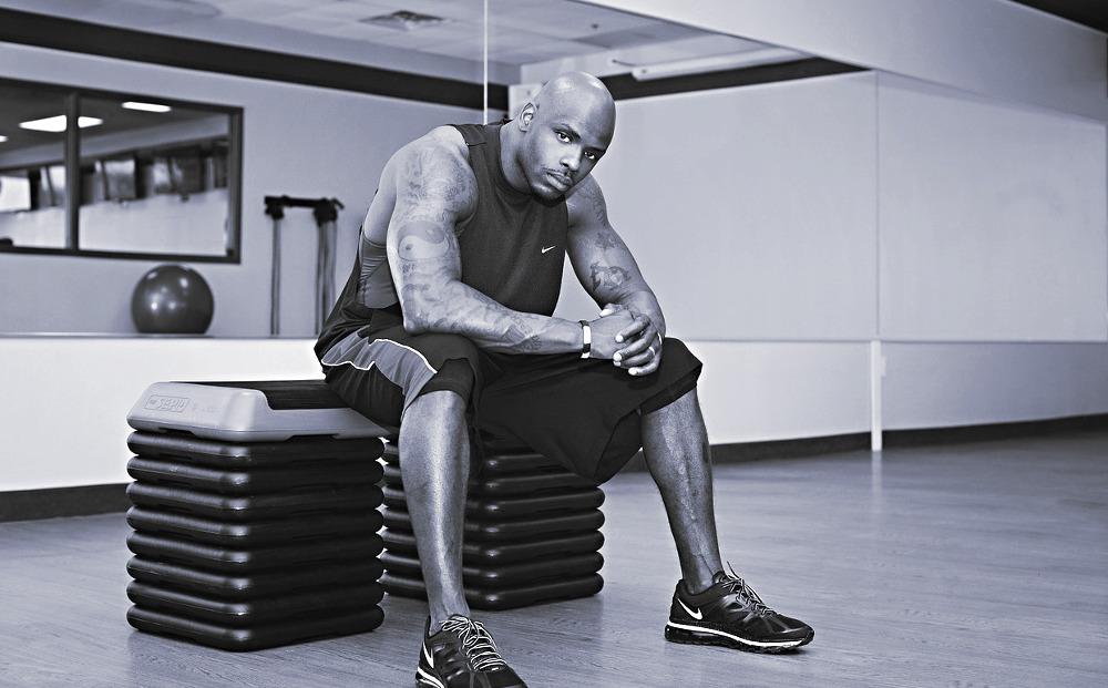 man sitting in gym