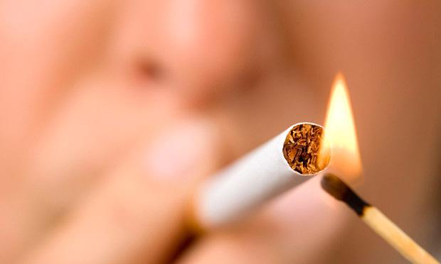 Matchstick lighting a cigarette